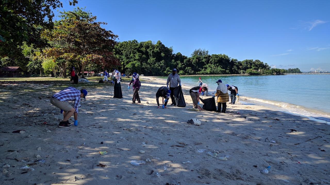 Collecting rubbish from beach